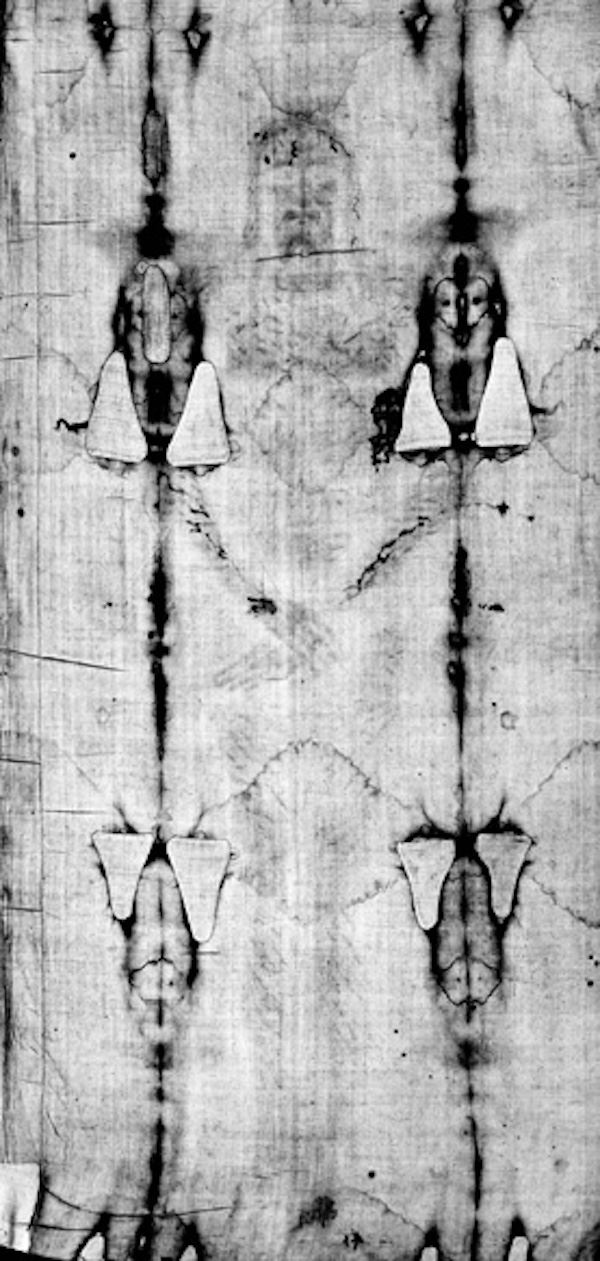 black and white photo of burned shroud of turin