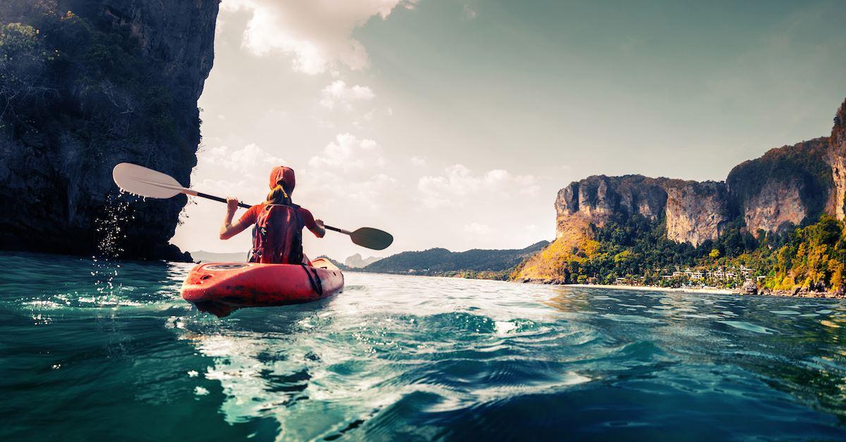 woman kayaking in ocean, wanderlust