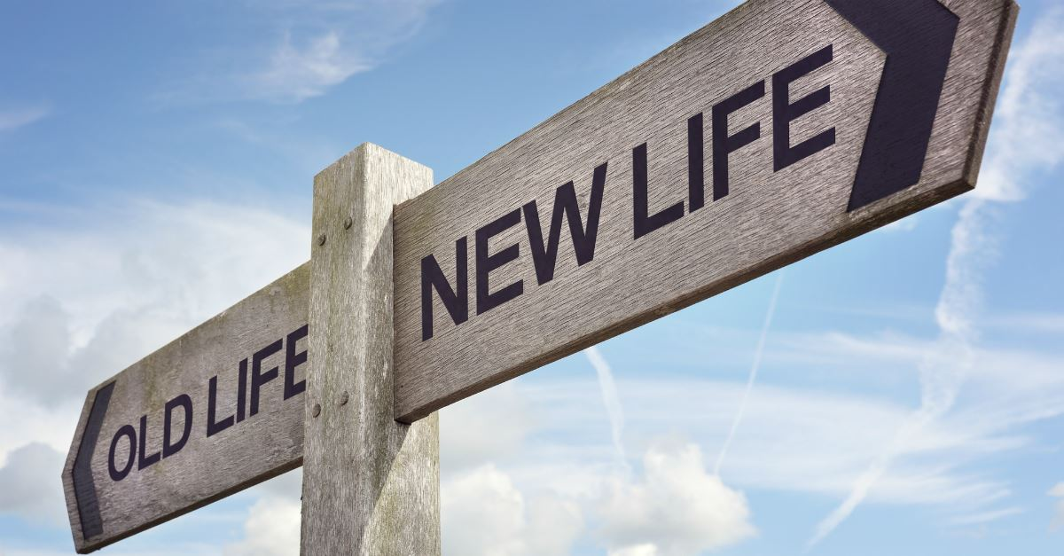 road sign pointing to old life and new life