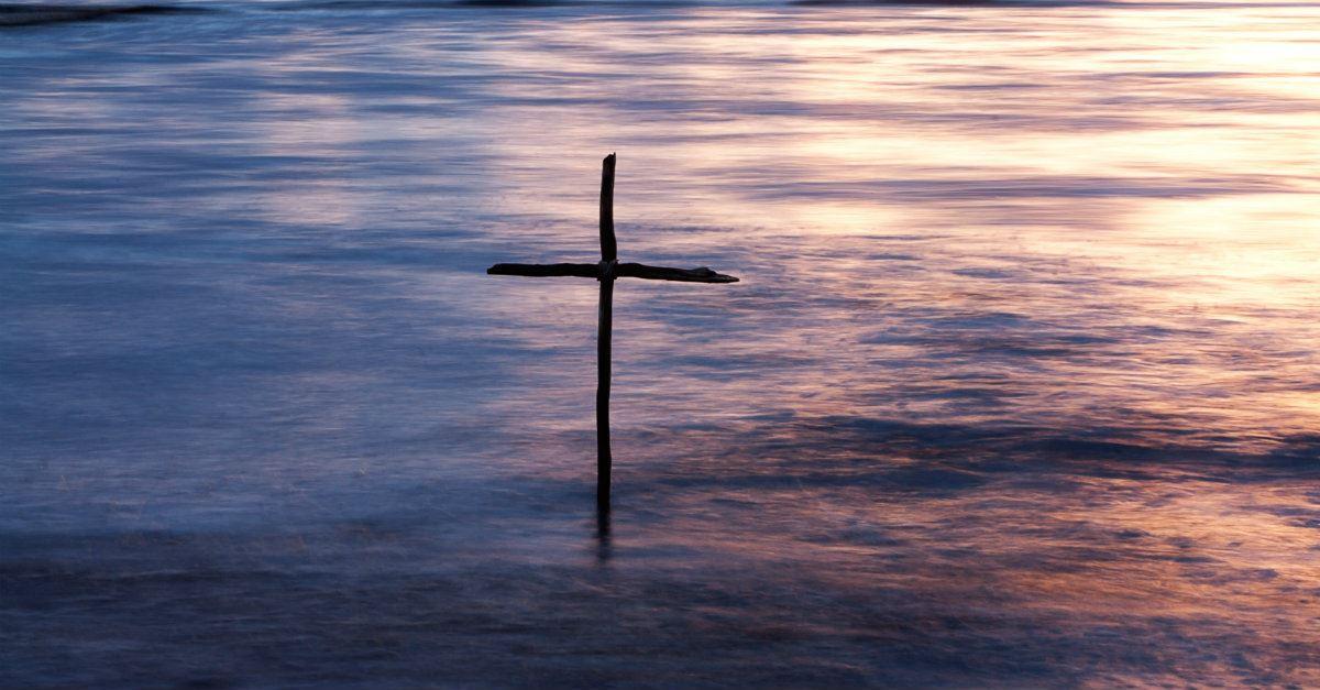 cross in water baptism concept