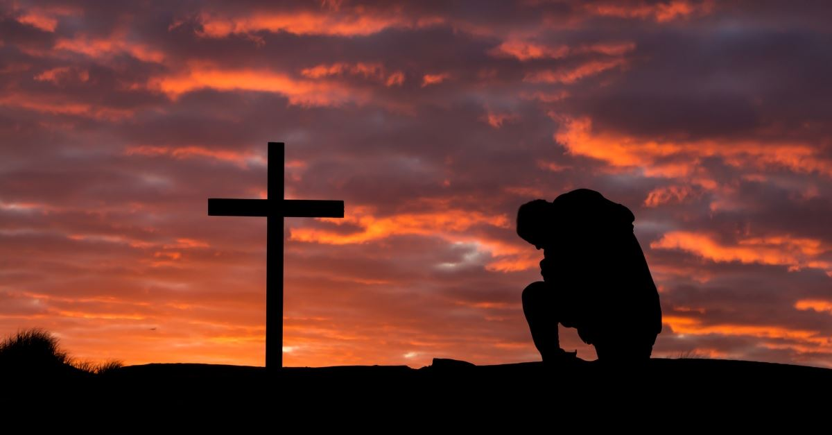 a man kneeling to pray at the cross, how to step up to the altar and not brag