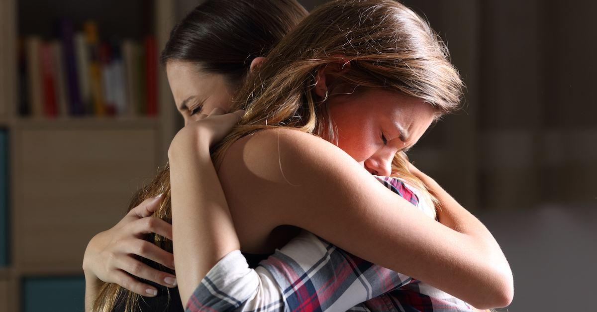 sad teens hugging, grief