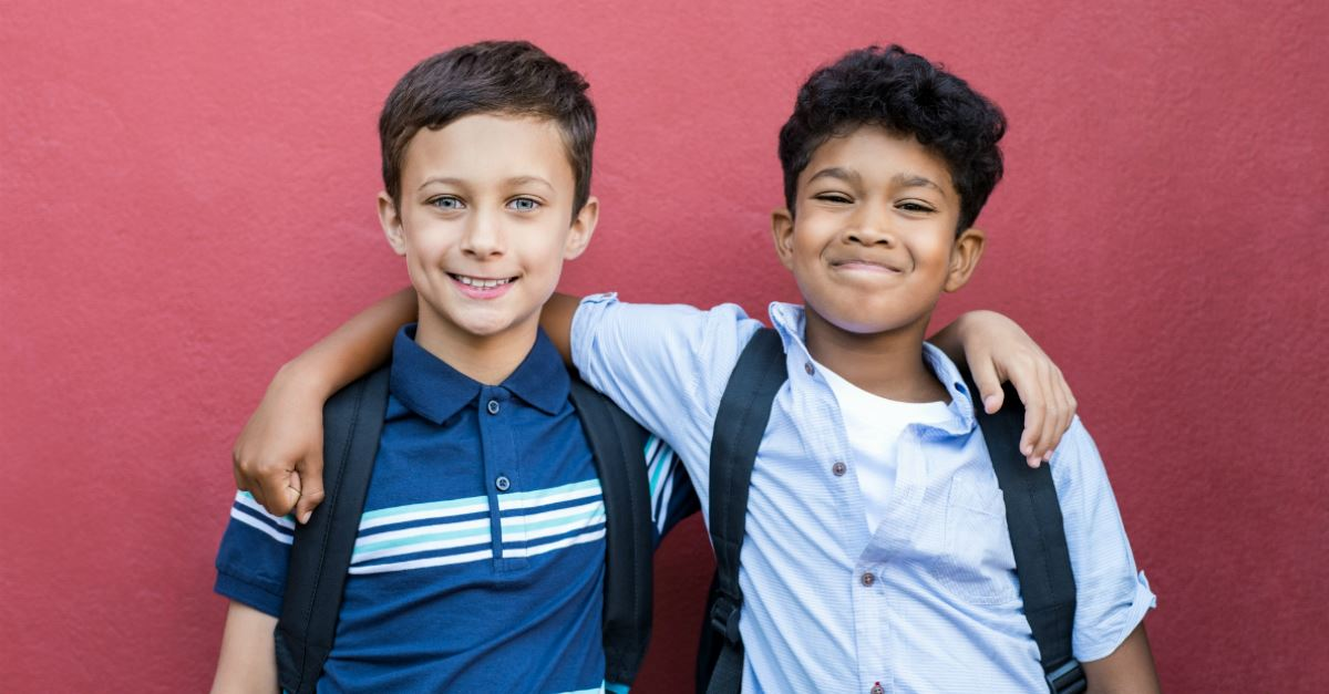young boys with backpacks