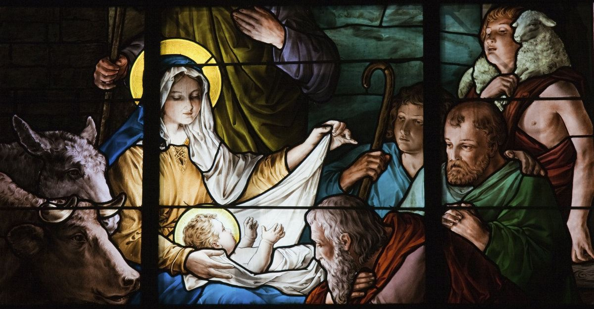 stained glass window of manger scene