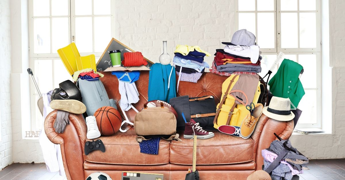 messy couch full of stuff, redefine organization