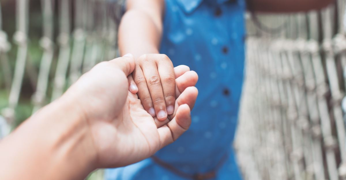 parent holding hand of child outstretched, discipling children can change generation