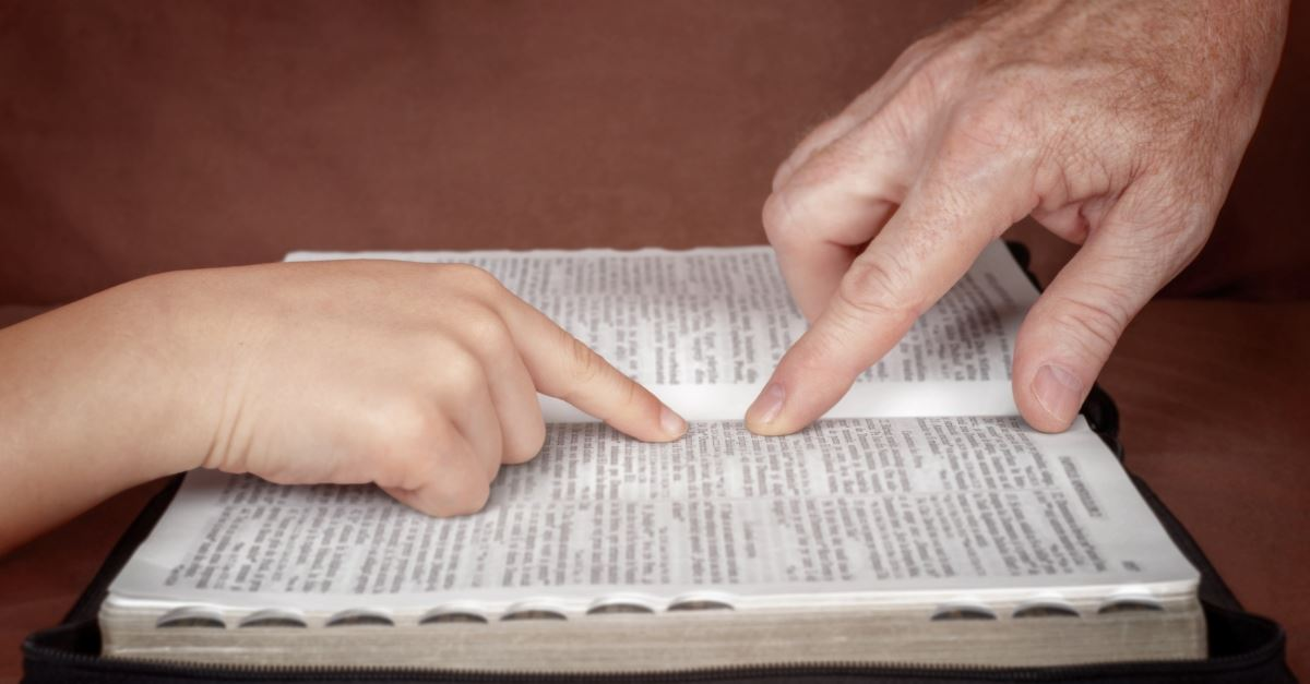 father and child reading the Bible together, things to teach your children about the Holy Spirit