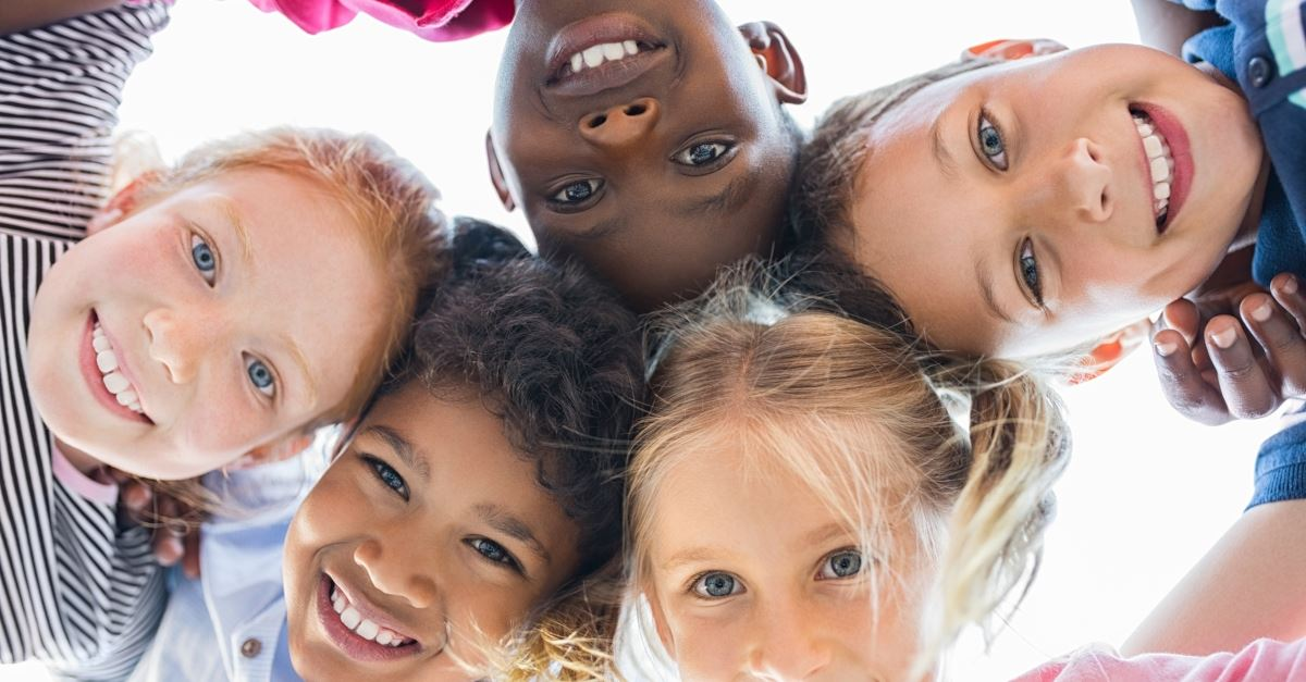 circle of smiling multiethnic diverse children
