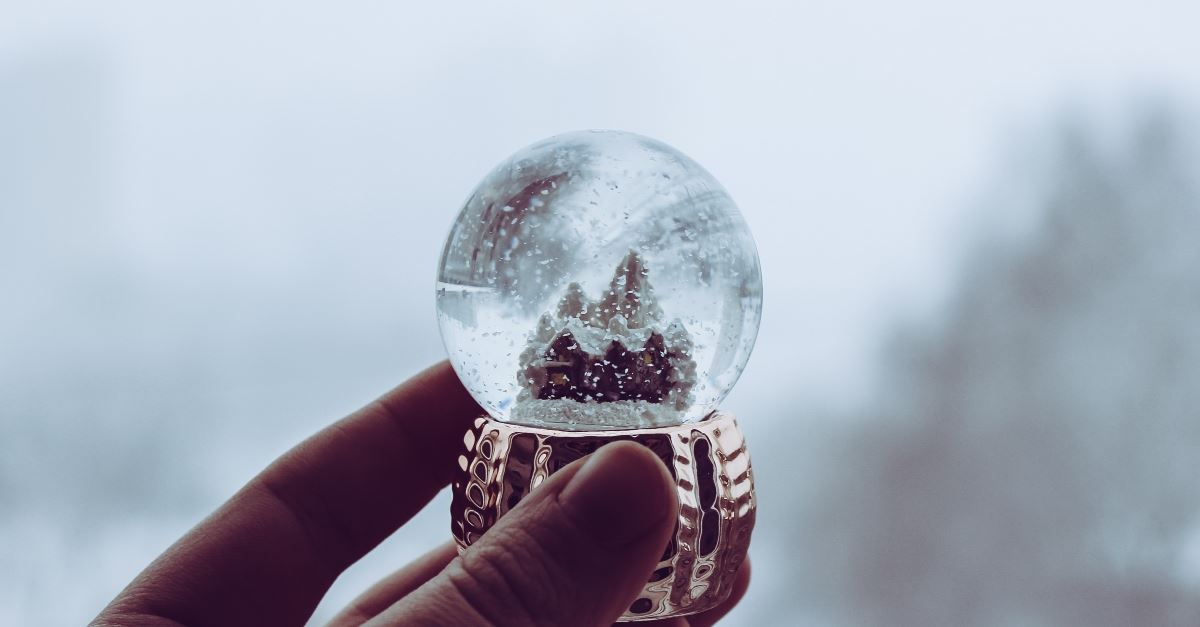 hand holding snowglobe