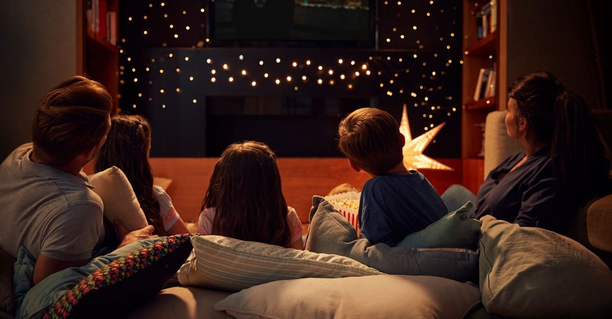 family watching movie together at night