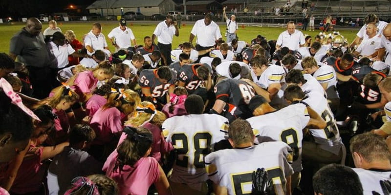 Georgia School District Forced to Pay Atheist Group $22,500 for Coach-Led Prayers