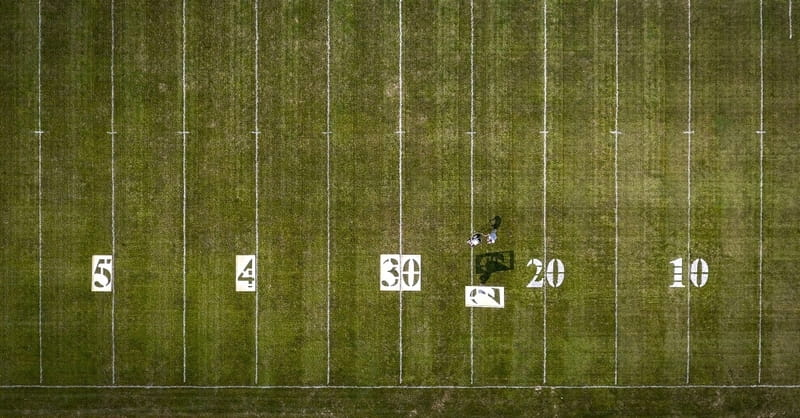 High School Paints over the Name of Christ in Football Field Logo