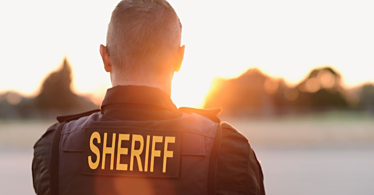 Fired for Following the 'Billy Graham Rule'? Former Sheriff Deputy Is Suing