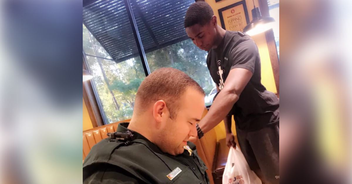 Photo of Young Man Praying Over Police Deputy Goes Viral