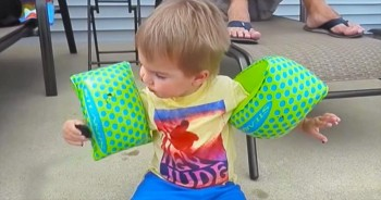 Floaties Are Great For The Water But Not When You're Trying To Eat A Cookie – Poor Kid!