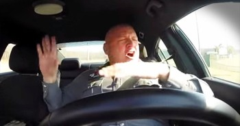 Dash Cam Records Police Officer Hilariously Singing In Car