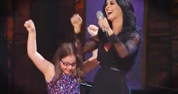 Beautiful Young Girl With Autism Performs With A Superstar