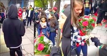 Little Boy Patiently Waits For Crush With Flowers