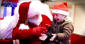 Santa Talks To Little Girl In Sign Language