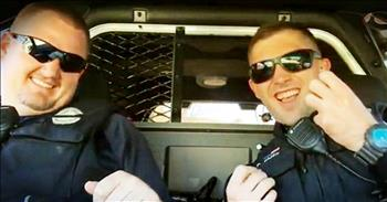 Police Officers Sing 'Don't Stop Believing' To Encourage Other Officers