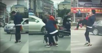 Young Man Drops Everything To Help Elderly Woman Cross Street