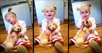 Little Girl And Her Puppy Share Precious Snuggles