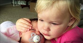 Sweet Toddler Stops Crying When She Hugs Baby Sister