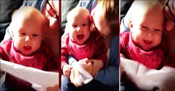 Baby Hysterically Giggles At A Piece Of Paper