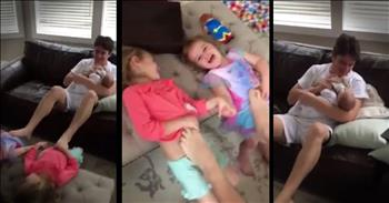 Multi-Tasking Dad Feeds Baby And Plays With 2 Other Kids