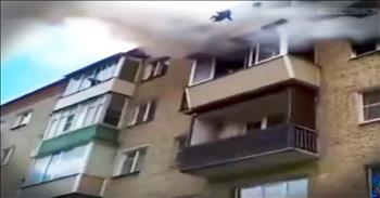 Strangers Save Family Leaping From Burning Building