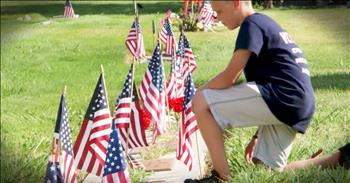 11-Year-Old Puts Flags On Veteran's Graves