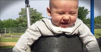 Baby Is So Happy In Swing Set