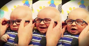 Baby With Glasses Smiles At Momma