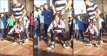 PE Teacher And Girl With Disability Dance