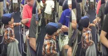 2-Year-Old Greets Plane Passengers With Fist Bump