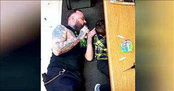 Barber Lays On The Floor For Boy With Autism