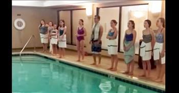 Children's Choir Sing Hymn Around Pool