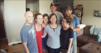 Family Photo Turns Into Pregnancy Announcement