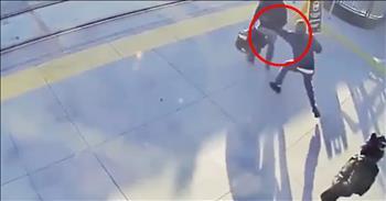 Stranger Saves Blind Man From Train