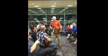 Musicians Play Guitar and Accordion At Airport