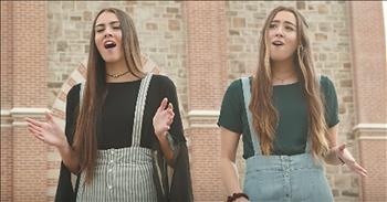 2 Girls Stand In Field And Sing 'Be Thou My Vision'