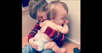 Big Brother Comforts Sick Baby Sister