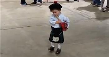 Toddler Plays Along With Bagpipes