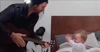 Dad Sweetly Serenades Baby Girl