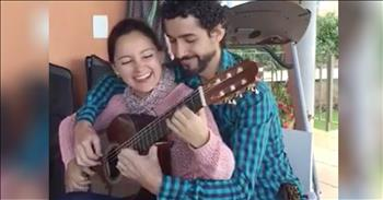 Couple Plays One Guitar At The Same Time