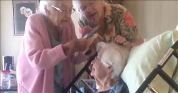 2 Women Brush Sister's Hair In Hospice