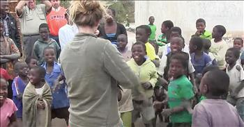Girl Plays Fiddle For Children Who've Never Heard One