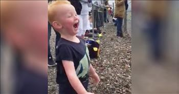 Excited Toddler Loves Motorcycle Race