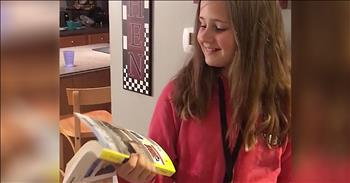 Young Girl Confused By Phone Book