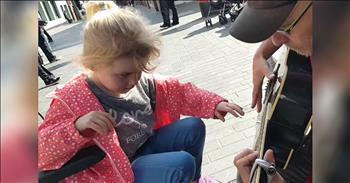 7-Year-Old Blind Girl Finds Joy In Street Busker's Music